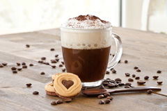 Cup of coffee with creamy milk foam Royalty Free Stock Photo