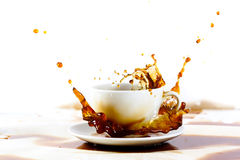 Cup of coffee creating splash Stock Photo