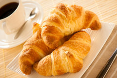 Cup of coffee and croisants served for breakfast Royalty Free Stock Image