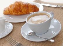 Cup of coffee with croissant Stock Photos