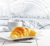 Cup of coffee and croissant in cafe Stock Image