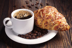 Cup of coffee and croissant with cheese Stock Photos