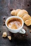 Cup of coffee with croissant Royalty Free Stock Images