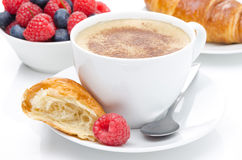 Cup of coffee, croissant and fresh raspberry for breakfast. Close-up Stock Photos