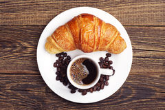 Cup coffee and croissant Stock Image