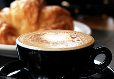 A Cup of Coffee and a Croissant Stock Photo