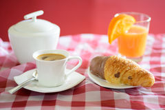 Cup of coffee, croissant, orange juice and a sugar bowl Stock Photos