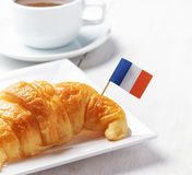 Cup of coffee and croissant in Paris cafe. Stock Photography