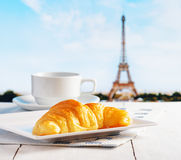 Cup of coffee and croissant in Paris Royalty Free Stock Photography