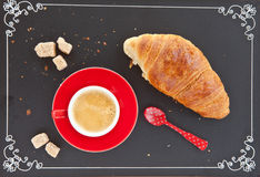 Cup of coffee and a croissant Royalty Free Stock Photos