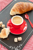 Cup of coffee and a croissant Stock Photos
