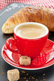 Cup of coffee and a croissant Royalty Free Stock Image