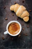 Cup of coffee with croissant Royalty Free Stock Photography