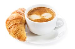 Cup of coffee and croissant on white background Royalty Free Stock Images