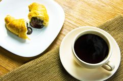 Cup of coffee and a croissant Stock Photo