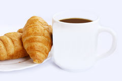 Cup of coffee and croissants stock images