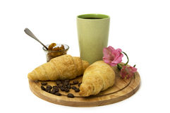 A cup of coffee and croissants Stock Image