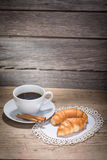 A cup of coffee and croissants Royalty Free Stock Photo