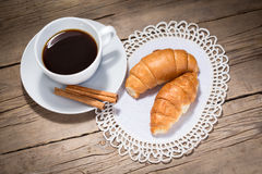 A cup of coffee and croissants Royalty Free Stock Image