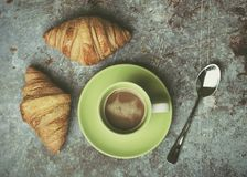 Cup of coffee and croissants. On Grunge background royalty free stock photo