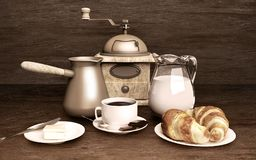 A Cup of coffee and croissants are located on the wooden table. Still life food Royalty Free Stock Photography