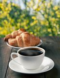 Cup of coffee with croissants Stock Images