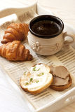 Cup of coffee with croissants and toasts Stock Images