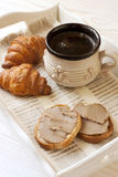 Cup of coffee with croissants and toasts Royalty Free Stock Image