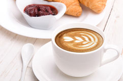 Cup of coffee with croissants. Royalty Free Stock Photos