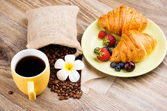 Cup of coffee and croissants. On wooden background Stock Images
