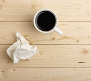 Cup of coffee and crumpled paper Stock Photos