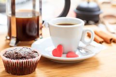 Cup of coffee and a cup cake on a wooden surface. Cup of coffee and a cup cake Stock Photo