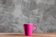 Cup of coffee. On grey wall background Stock Images