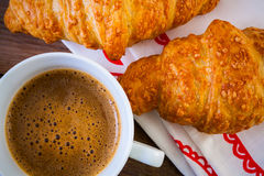 Cup of coffee cup with a croissant Stock Image