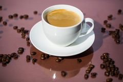 Cup of coffee, cup of espresso, latte macchiato, brown backgroun Royalty Free Stock Image