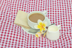 Cup of coffee and cup of milk put on fabric red, white Stock Image