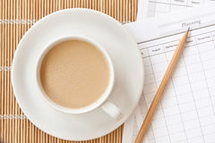 A cup of coffee cup with planning paper Royalty Free Stock Photos