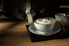 A cup of coffee and a cup of tea on the wood table. Stock Image