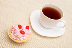Cup of coffee and cupcake. Cup of coffee and cupcake on the table Royalty Free Stock Photo