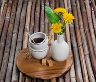 Cup of coffee, dandelions Royalty Free Stock Photos