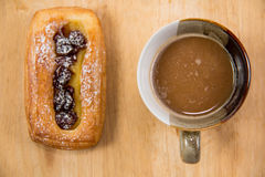 Cup of coffee and danish pastry. Royalty Free Stock Image
