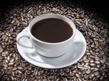 Cup of coffee. A cup of coffee on dark background Royalty Free Stock Photography