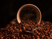 Cup of coffee. A cup of coffee on a dark background with smoke Royalty Free Stock Image