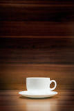Cup of coffee on dark wood background Royalty Free Stock Photography