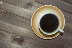 A Cup of coffee on a dark wooden table. royalty free stock photography