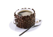 The cup of coffee,decorated by grains of coffee. Royalty Free Stock Photo