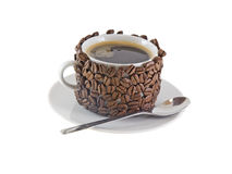 The cup of coffee,decorated by grains of coffee. Royalty Free Stock Photos