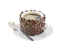 The cup of coffee,decorated by grains of coffee. Stock Photos