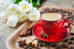 Cup of coffee on  decorated with spices and flowers Royalty Free Stock Photography