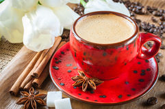 Cup of coffee on  decorated with spices and flowers Stock Photo